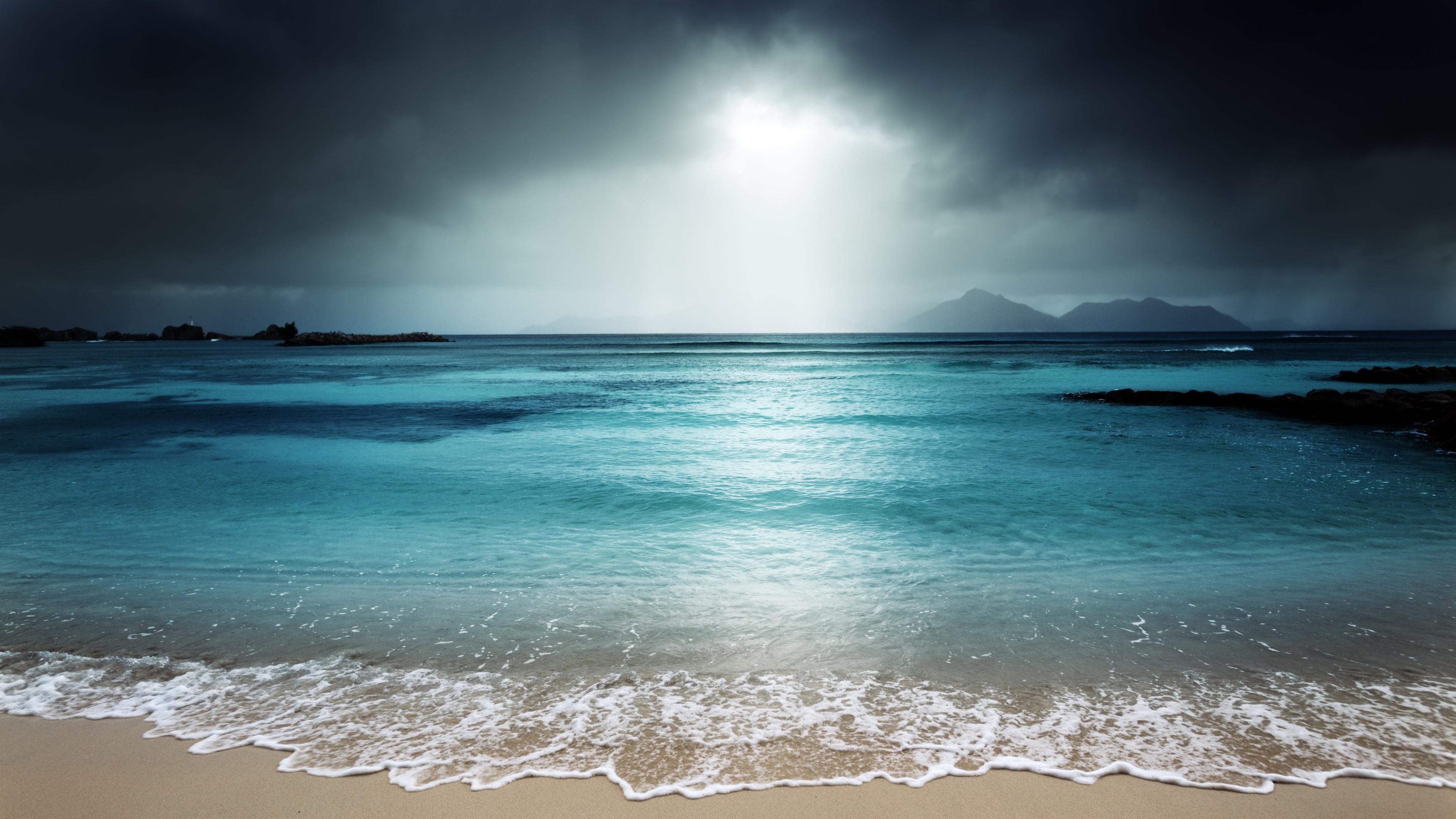 la_digue_island_beach_dark_sky_storm_5k